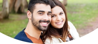 Couple with healthy smiles thanks to preventive dentistry