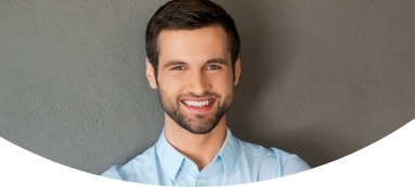 Man with healthy smile after Invisalign treatment