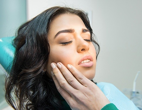 Woman in dental office before wisdom tooth extraction